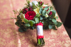 Beautiful wedding bouquet. Of different flowers with cotton Royalty Free Stock Photos