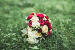 Beautiful wedding bouquet with different flowers, roses Stock Images