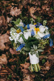 Beautiful wedding bouquet of different white, blue, green flower Stock Image