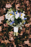 Beautiful wedding bouquet of different white, blue, green flower Royalty Free Stock Image