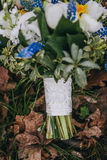 Beautiful wedding bouquet of different white, blue, green flower Royalty Free Stock Images