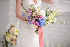 Beautiful Wedding bouquet. Wedding bouquet of beautiful flowers. The bride's bouquet royalty free stock photography