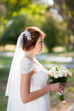 Beautiful wedding bouquet of flowers in hands of young bride Royalty Free Stock Images