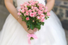 Beautiful wedding bouquet. In hand Stock Photo