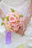 Beautiful wedding bouquet. Beautiful wedding bouquet in hands of the bride Royalty Free Stock Photography