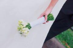 Beautiful wedding bouquet in hands Stock Photos