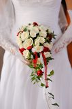Beautiful wedding bouquet in hands of the bride Stock Photos