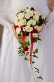 Beautiful wedding bouquet in hands of the bride Stock Image