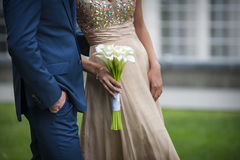 Beautiful wedding bouquet in hands of the bride Stock Images