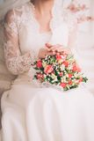 Beautiful wedding bouquet in hands of the bride Royalty Free Stock Photography