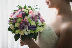 Beautiful wedding bouquet. Beautiful wedding bouquet in hands of the bride Stock Photo