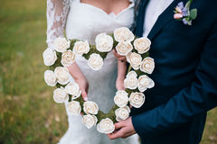 Beautiful wedding bouquet in hands Royalty Free Stock Photography