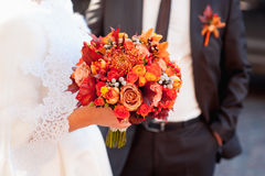Beautiful wedding bouquet in hands of the bride Stock Photography