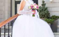 Beautiful wedding bouquet in hands of the bride.  Stock Images