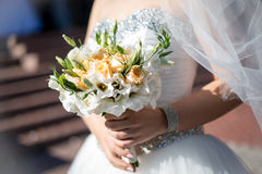 Beautiful wedding bouquet hands of the bride. Beautiful wedding bouquet in hands of the bride Royalty Free Stock Photos