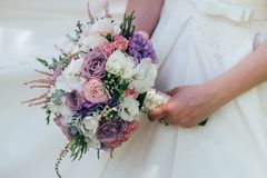 Beautiful wedding bouquet in the hands of the bride. Wedding day Royalty Free Stock Photo