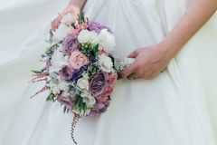 Beautiful wedding bouquet in the hands of the bride. Wedding day Stock Photo