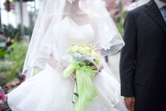 Beautiful wedding bouquet in hands of the bride Stock Photo