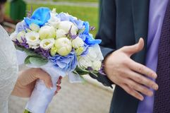 Beautiful wedding bouquet in the hands of the bride stock photography