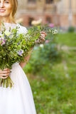Beautiful wedding bouquet in the hands of the bride Royalty Free Stock Images