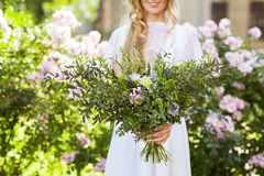 Beautiful wedding bouquet in the hands of the bride Royalty Free Stock Image