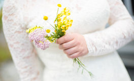 Beautiful wedding bouquet in hands of the bride Royalty Free Stock Photos
