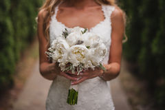 Beautiful wedding bouquet in hands of the bride Royalty Free Stock Images