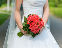 Beautiful wedding bouquet in the hands of the bride Stock Image