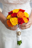 Beautiful wedding a bouquet in hands of the bride Stock Photos