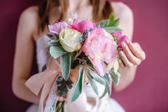Beautiful wedding bouquet in hands of the bride. Selective focus Royalty Free Stock Photos