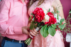 Beautiful wedding bouquet in hands of the bride. Selective focus Royalty Free Stock Images