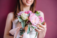 Beautiful wedding bouquet in hands of the bride. Selective focus Royalty Free Stock Photo