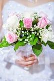 Beautiful wedding bouquet in hands of the bride Stock Photos