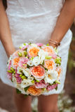 Beautiful wedding a bouquet in hands of the bride Royalty Free Stock Image