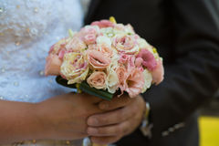 Beautiful wedding bouquet in the hands of the couple. Royalty Free Stock Photography