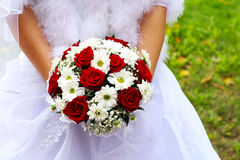 Beautiful wedding bouquet in hands Royalty Free Stock Images