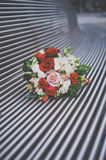 Beautiful wedding bouquet on the iron bench Royalty Free Stock Photo