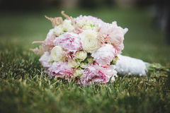 Beautiful  wedding bouquet laying on the lawn Royalty Free Stock Photo