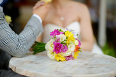Beautiful wedding bouquet laying on a table Royalty Free Stock Photos