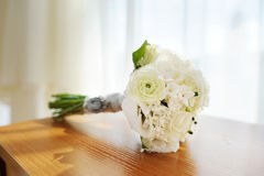 Beautiful wedding bouquet laying on a table Stock Photography