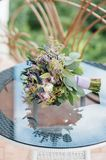 Beautiful wedding bouquet lie on glass table stock image