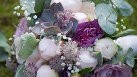 Beautiful wedding bouquet lies on the grass.  stock video footage
