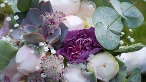 Beautiful wedding bouquet lies on the grass.  stock video