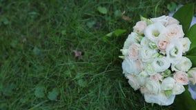 Beautiful wedding bouquet lies on the grass. Beautiful wedding bouquet lies on the grass stock video footage