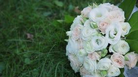 Beautiful wedding bouquet lies on the grass. Beautiful wedding bouquet lies on the grass stock footage