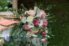 A wedding bouquet lies on a dressing table. Morning of the bride. Scenery. stock photography