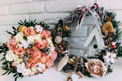 Beautiful wedding bouquet in a New Year`s interior. Beautiful bridal bouquet standing near the Christmas decorations Stock Photography