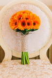 Beautiful wedding bouquet of orange flowers Stock Images