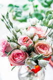 Beautiful wedding bouquet of pink and white roses, wedding rings lie on top Stock Images