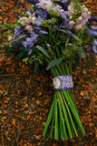 Beautiful Wedding bouquet. Beautiful purple wedding bouquet on wooden background Royalty Free Stock Photos